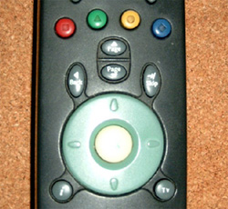 Standard set-top box remote control with navigation options in circular arrangement